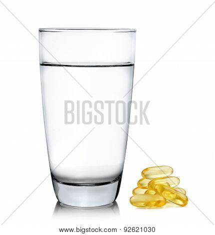 Glass Of Water And Fish Oil Isolated On White Background
