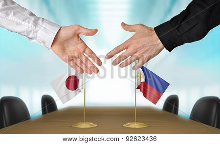 Japan and Philippines diplomats agreeing on a deal