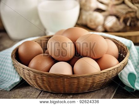 Easter Egg In A Basket On Wodden Table