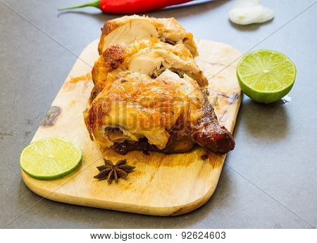 Roasted Chicken On The Wooden.