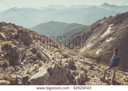 Hiker Standing On Rocky Mountain Footpath