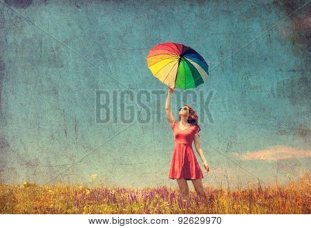 Girl In Red Dress With Umbrella On Meadow