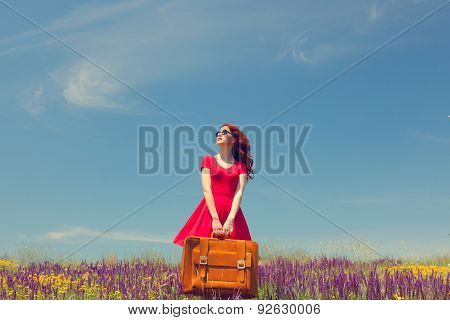 Girl In Red Dress With Suitcase