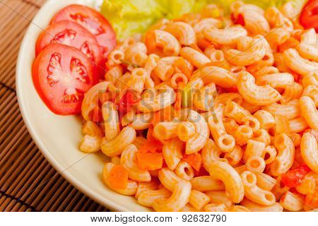 Fried macaroni with egg,chicken and vegetable in tomato sauce.