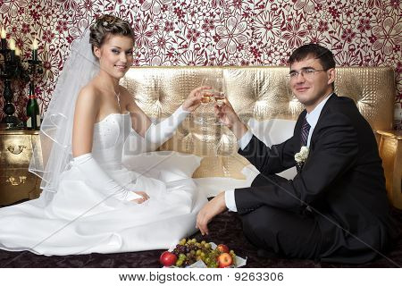 newlyweds in bedroom