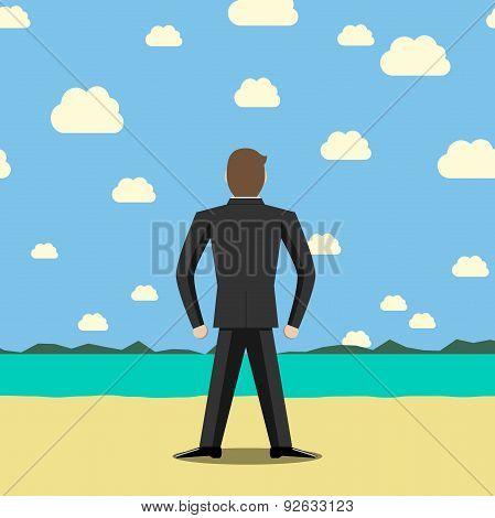Businessman Standing On Beach