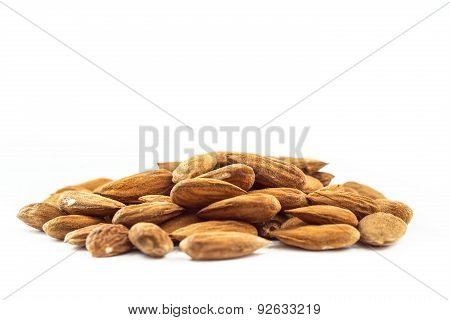 Almonds In Heap Over White