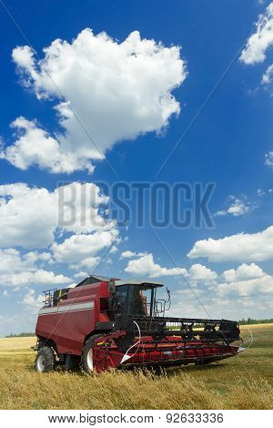 Combine Machine With Header Or Cutting Blade Standing In Oat Farm Field