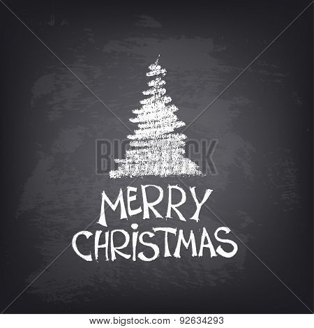 Hand drawn Merry Christmas text with stylized tree on blackboard.