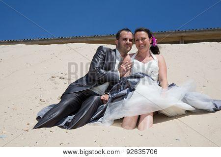 Newlywed Couple  On The Beach Under Blue Sky