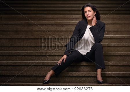 Attractive Brunette Woman Posing On Urban Stairs