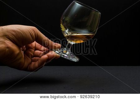 Cognac Glass In Human Hand
