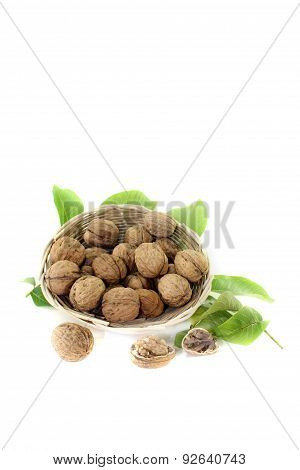Walnuts With Walnut Leaves In A Basket