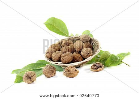 Crunchy Walnuts With Walnut Leaves In A Basket