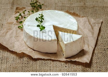 Camembert gourmet round cheese traditional French delicious dairy creamy meal  with thyme on rustic