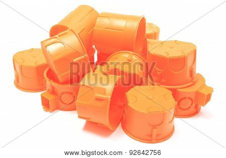Heap Of Orange Electrical Boxes On White Background