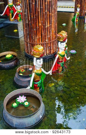 Vietnamese Statues In The Pool