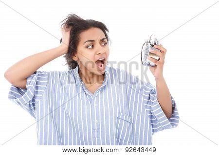 Excited young woman with alarm clock