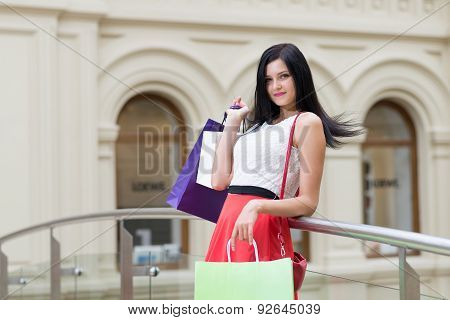 A Beautiful Young Brunette With A Lot Of Bags From The Fancy Shops. Shopping, Sale, Gifts And Holida