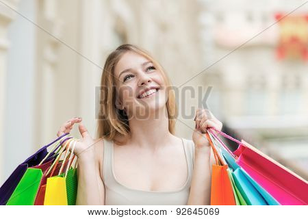 A Happy Young Girl With The Colourful Shopping Bags From The Fancy Shops.
