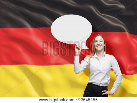 Woman Is Pointing Out The Blank Thought Bubble. German Flag As A Background.