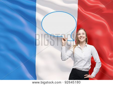 Woman Is Pointing Out The Blank Speech Bubble. French Flag As A Background.