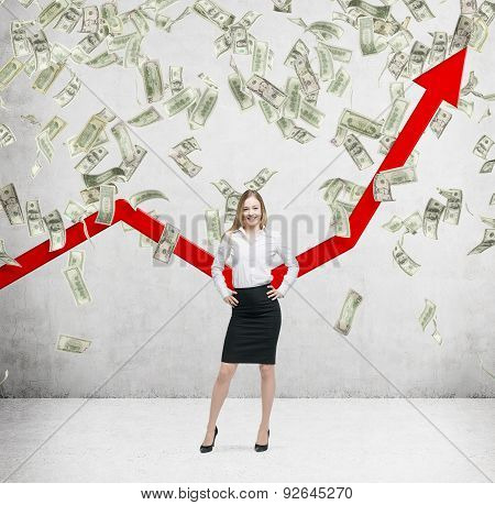Full-length Smiling Business Lady Stands Among Falling Dollar Bills From The Ceiling. Red Arrow Is G