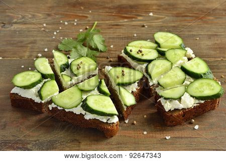 Sandwich with cream cheese cucumber and cilantro