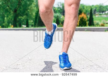 Handsome sportsman training outdoors