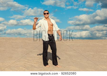 Man With Cigar In The Desert.