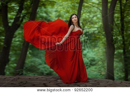 Girl In Red On The Edge Of A Precipice.