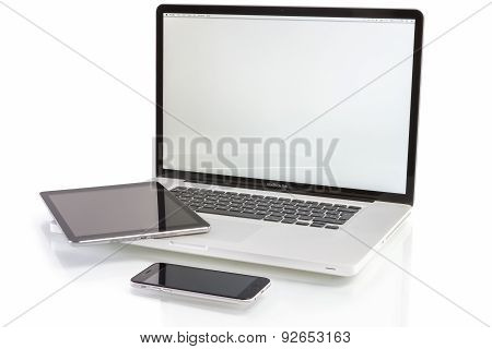 Macbook Pro, Ipad Air and Iphone 6 on White Background