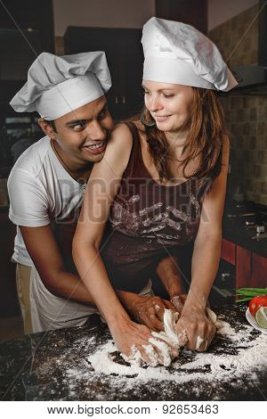 Attractive Mixed Race Young couple cooking dinner