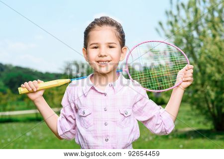 Happy family playing badminton