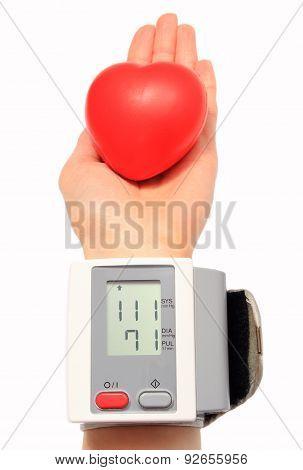 Measuring Blood Pressure And Red Heart In Hand