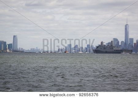 JERSEY CITY, NJ - MAY 20 2015: USS San Antonio (LPD 17) passes between the Statue of Liberty and the Freedom Tower at One WTC along the Hudson River. The Parade of Ships marks the start of Fleet Week.