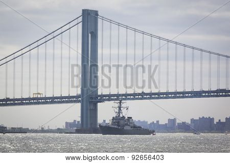 STATEN ISLAND, NY - MAY 20 2015: USS Stout (DDG 55) passes under the Verrazano-Narrows Bridge on the Upper Bay during the Parade of Ships, which begins Fleet Week.