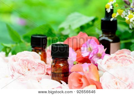 essential oils with roses and herbs