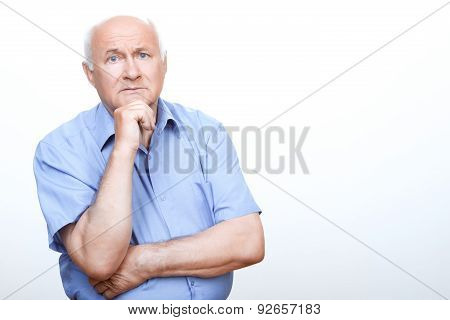 Puzzled grandfather involved in thinking