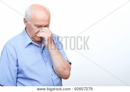 Anxious grandfather touching his head