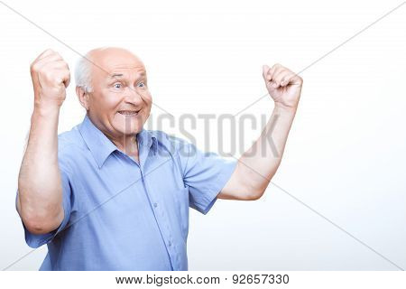 Laughing grandfather holding hands up