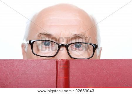 Wise grandfather in glasses holding book