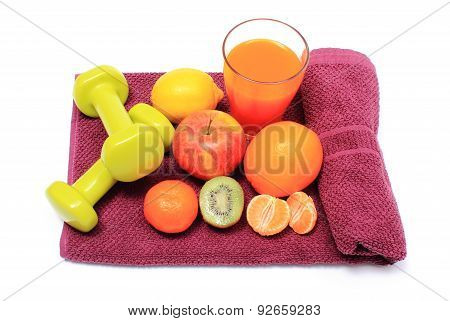 Fresh Fruits, Glass Of Juice And Dumbbells On Purple Towel
