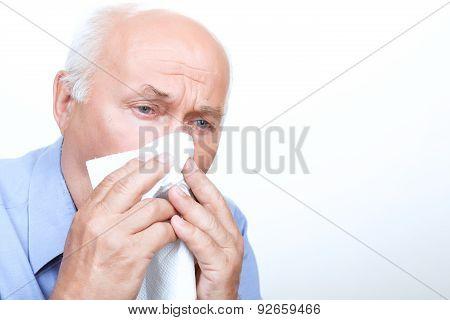 Ill grandfather holding handkerchief