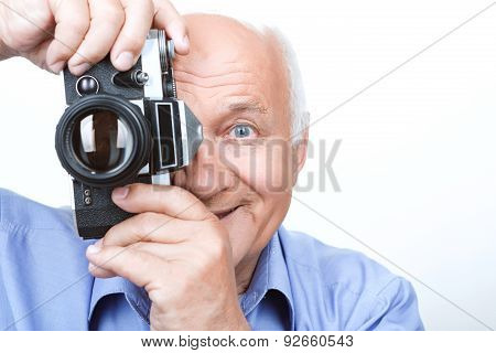 Vivacious grandfather holding camera