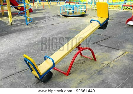 Empty seesaw on playground in public park