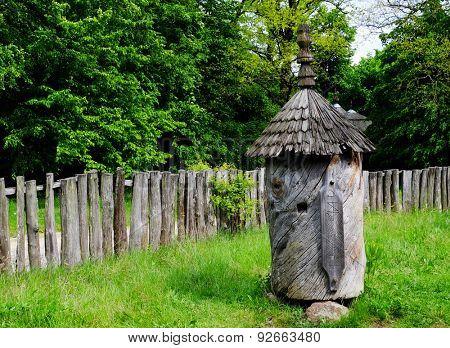 Old wooden bee hive in garden