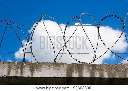 Barbed Wire On Top Of The Concrete Fences