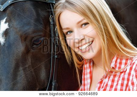 Close up of smiling girl with the horse