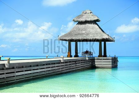 Arbor over blue ocean in Baros Maldives